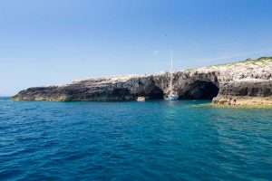 view on the green cave entrance from speedboat