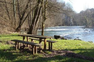 Wooden chairs by Krka river